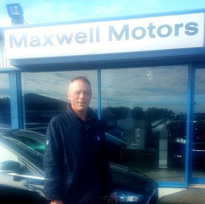 PORTEOUS ARRIVES AT MAXWELL MOTORS...