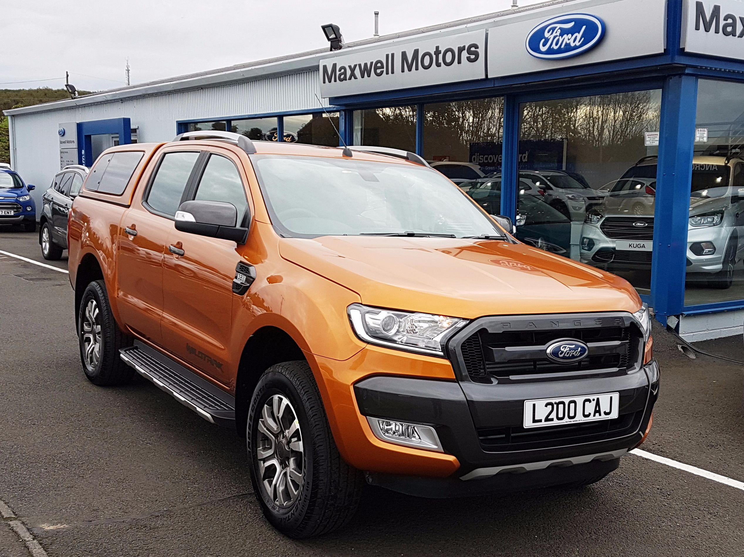 CUSTOMER COLLECTS PRIDE ORANGE WILDTRAK...